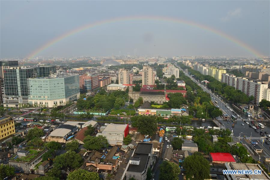 Beijing sees rainbow after rain
