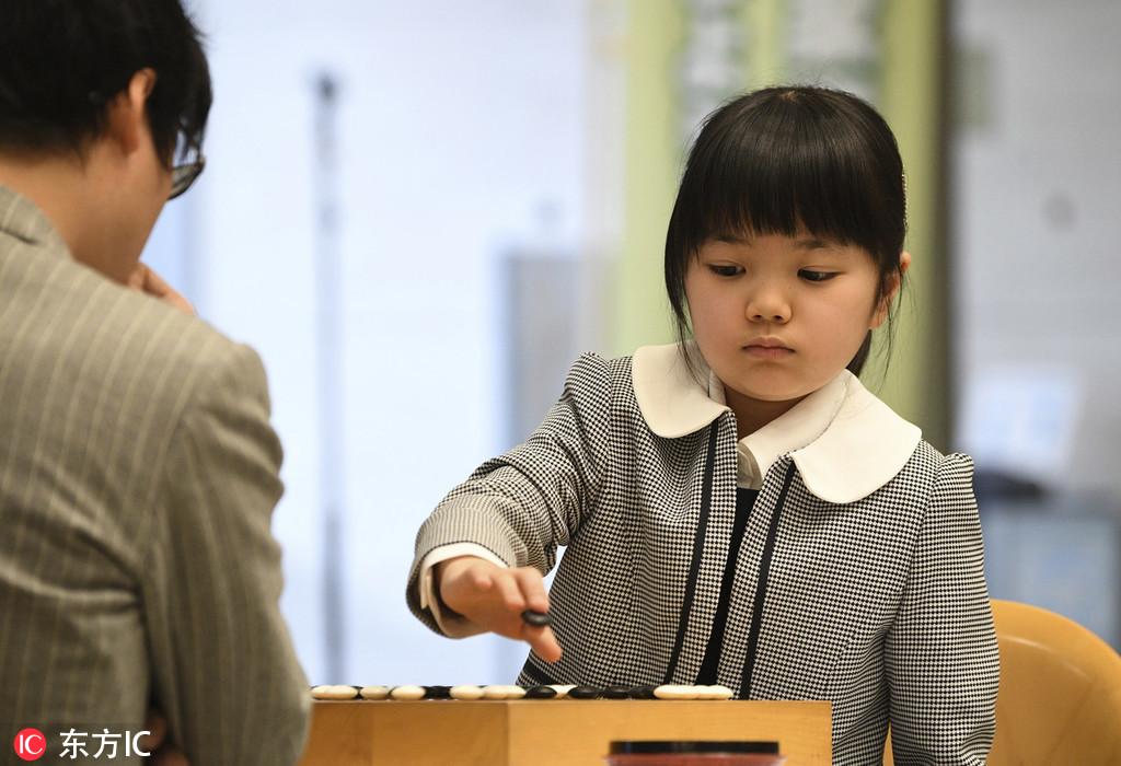 井山裕太九段_日本最年轻的职业围棋选手与顶级棋手井山裕太较量-送豆网